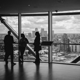 People Observing View From Building Top
